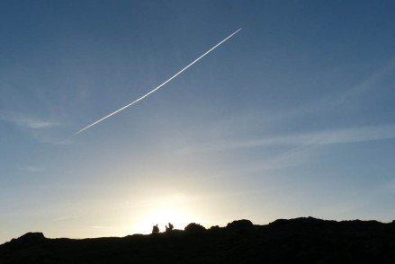 Hilltop and contrail