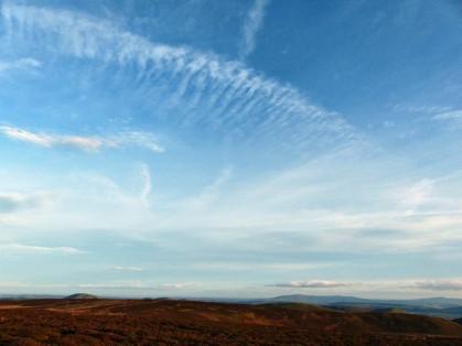 Cirrus over distant hills