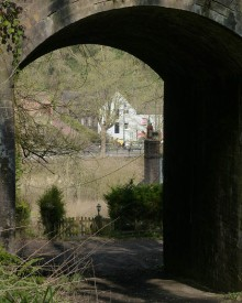 Under the arch, across the river