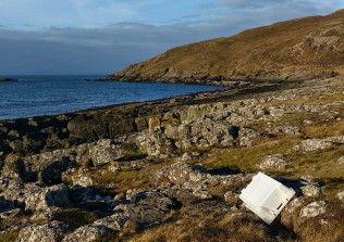 Rocky shore with fish box