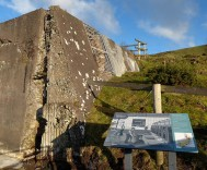 Crumbling concrete and Interpretation board