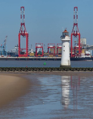 Lighthouse and cranes