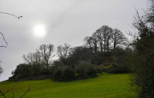 A watery sun beyond Round Hill