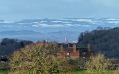 Snow on the border hills; St Chad's and the market hall, Shrewsbury