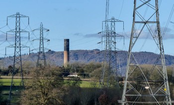 Pylons, chimney and the Wrekin