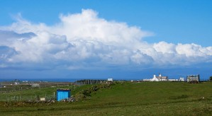 Blue shed and cloud bank